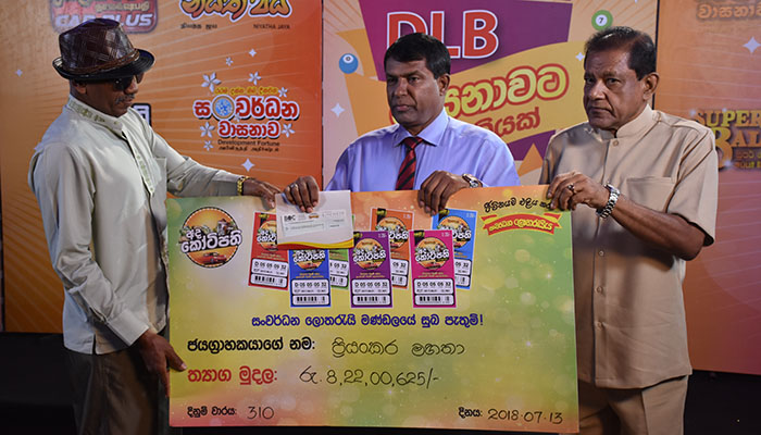 Prizes to 8th Millioner presented by Development Lotteries Board