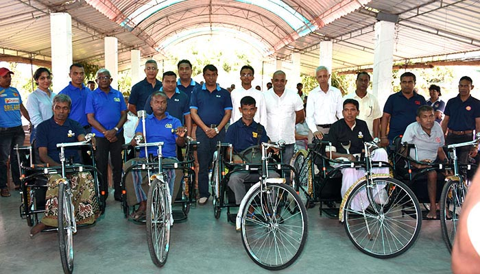 DLB presents tricycles to the Differently abled sales assistants in Badulla district