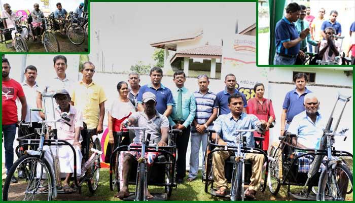 Tricycles for Sales Assistants of Gampaha from Development Lotteries Board