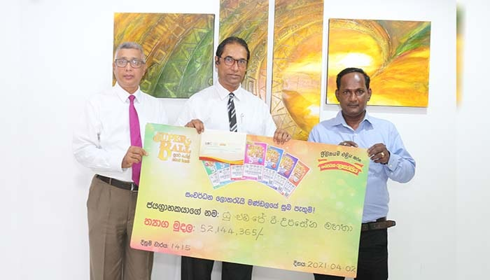DLB awarded the cheque to Super Ball super jackpot winner