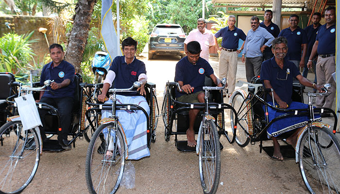 Tricycles from DLB to the differently abled Sales Assistants